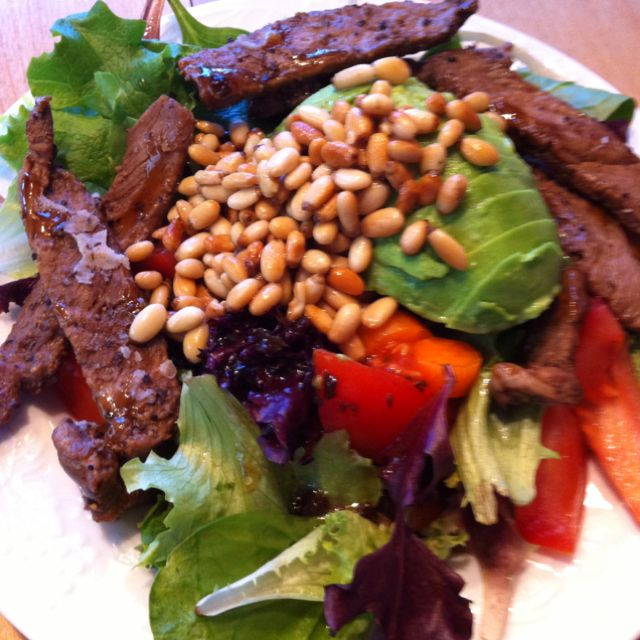 Steak and Pine Nut Salad Super easy.. cook your steak and season how you like and cut into strips. Can either have it cold or warm on your salad. I used mix greens, half a tomato, carrots and half an avocado. Toast half a cup of pine nuts in a skillet on low heat until golden brown ( I melted coconut oil in the skillet first before adding the pine nuts). Dressing- balsamic vinaigrette and added a teaspoon of honey to it. Yum!!!