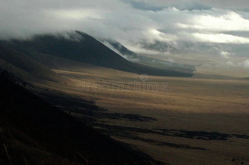 I stand on the lip of the ngorongoro crater in Tanzania and s Ngorongoro crater I stand on the lip of the ngorongoro crater in Tanzania and s  Curve road with a misty vol...
