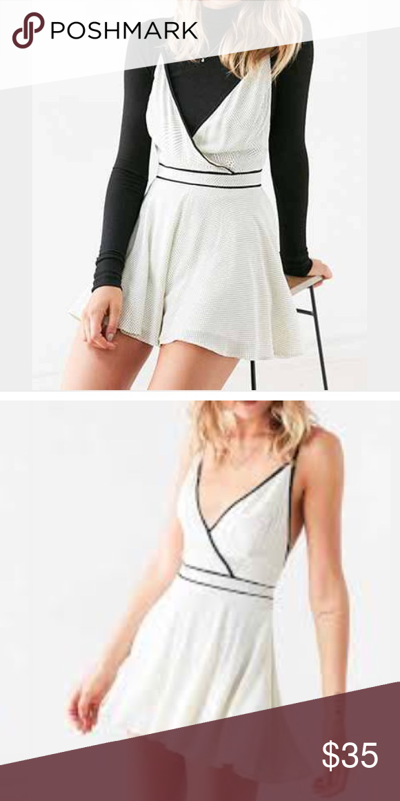New! UO Romper White romper with black tiny polka dot pattern. Super comfortable and cute! Urban Outfitters Pants Jumpsuits & Rompers