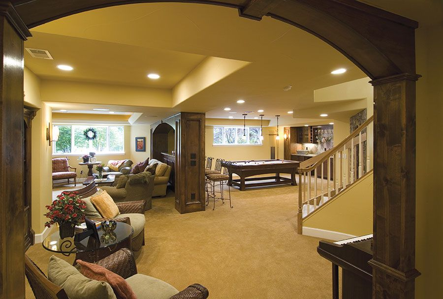 Basement Great Room And Wooden Archway Wainscoting Bedroom