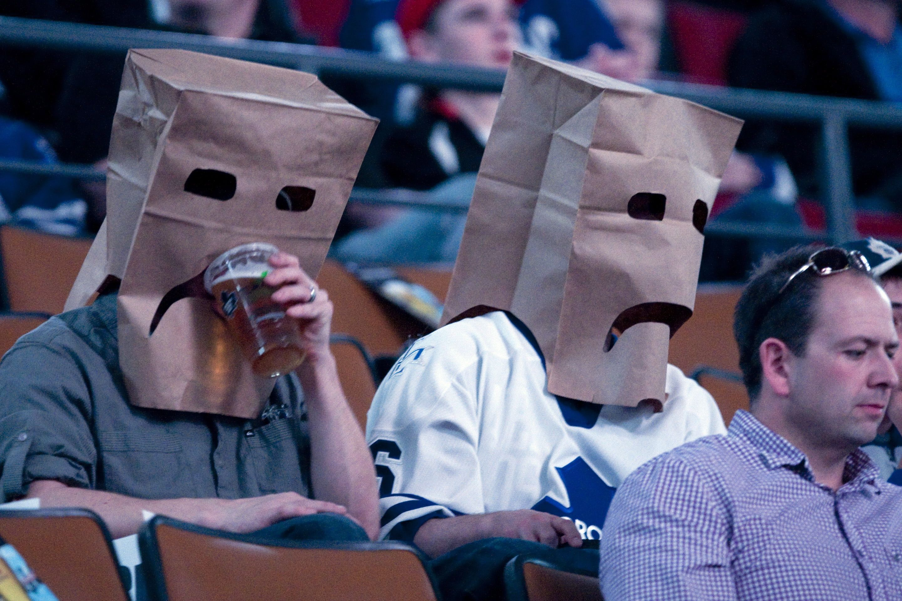 Toronto Maple Leafs Fans Wear Paper Bags Before The Maple Leafs Game Against New York Islanders Leafs Game Funny Sports Pictures Sports Pictures