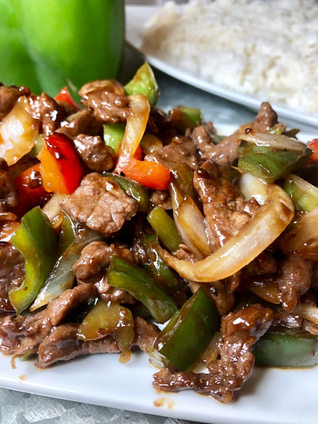pepper steak is a tasty asian style dish served on a bed of white rice recipe in 2020 pepper steak stuffed peppers beef dinner pinterest
