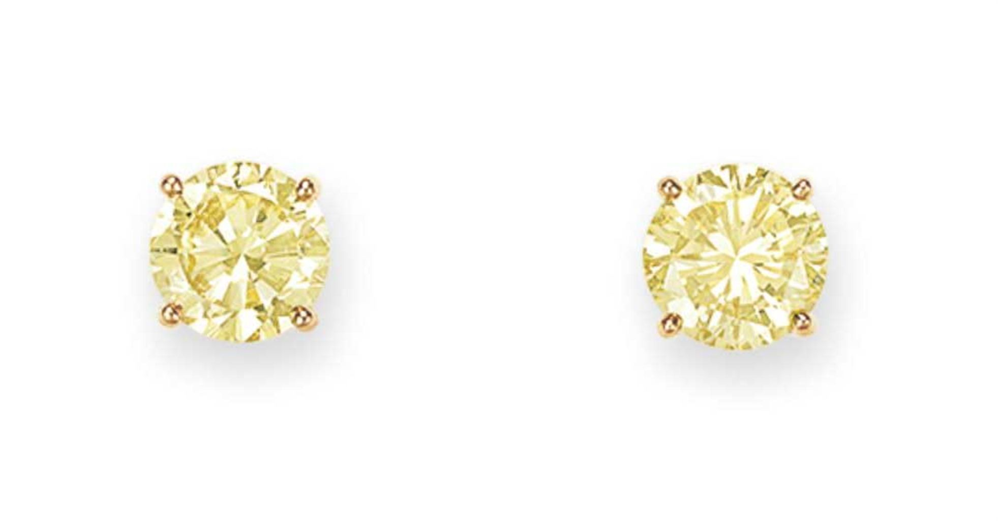 A pair of colored diamond ear studs by Tiffany & Co. #christiesjewels