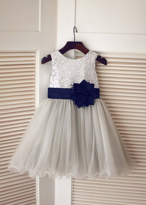 7a042cfe The materials for this dress is sequin,satin and tulle.The listed color is  silver top,gray skirt with navy blue flower sash.The sash is folded and has  a ...