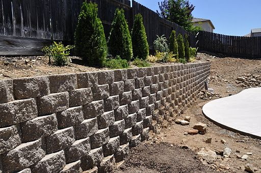 048 Retaining Wall along fence