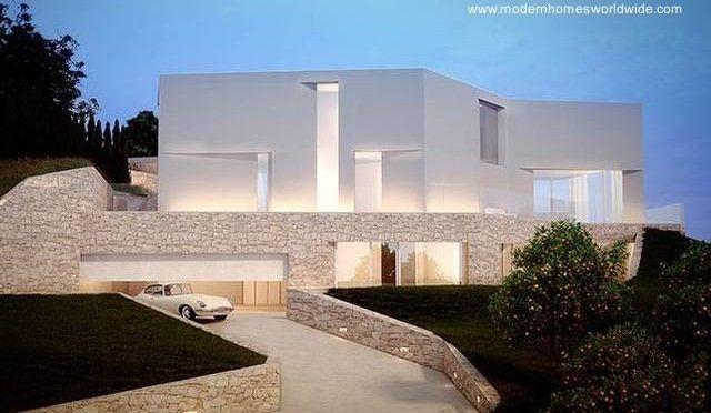 Vista nocturna de la fachada contraria al mar es una - Casas minimalistas en espana ...