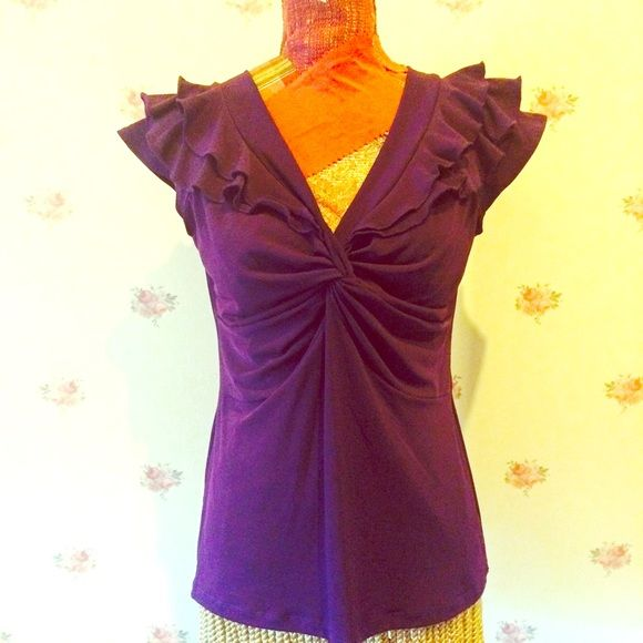 """BOGO! Deep purple ruffle Vneck knotfront blouse So flattering on! Note that it looks great on manikin with 34"""" bust, but measures 38"""" and looks terrific on a larger girl too! 95 poly, 5% spandex. Color closer to first pic. Tops Blouses"""