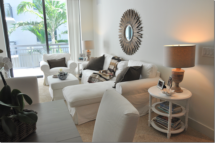 Bright And Open Apartment With White Walls Beige Carpeting The Room Features A