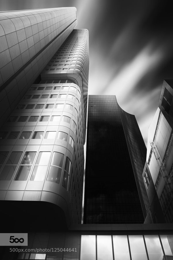 Silver Tower - Pinned by Mak Khalaf This picture shows the Silver Tower and the Skyper in Frankfurt Germany. City and Architecture architectureblack and whitecityscapecloudslongexposurelowkeyskyskylineskyscrapertowerurban by doriandiefenbach