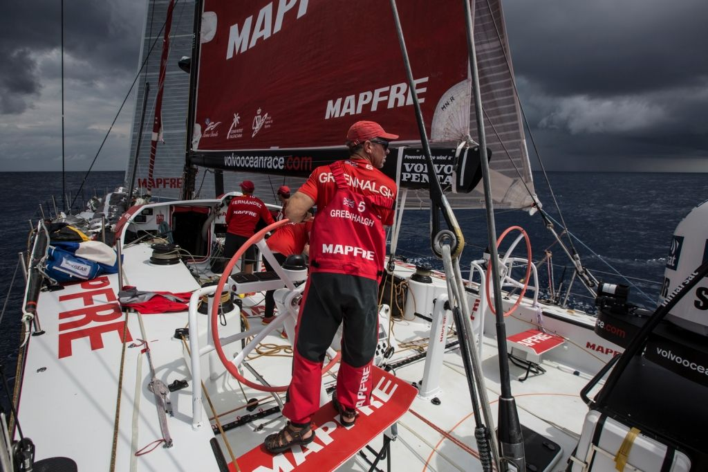 February 12, 2015. Leg 4 too Auckland onboard MAPFRE. Day 4. A nasty rain cloud in front of MAPFRE, Rob Greenhalgh is looking at Abu Dhabi that is getting closer and closer - Francisco Vignale/MAPFRE/Volvo Ocean Race
