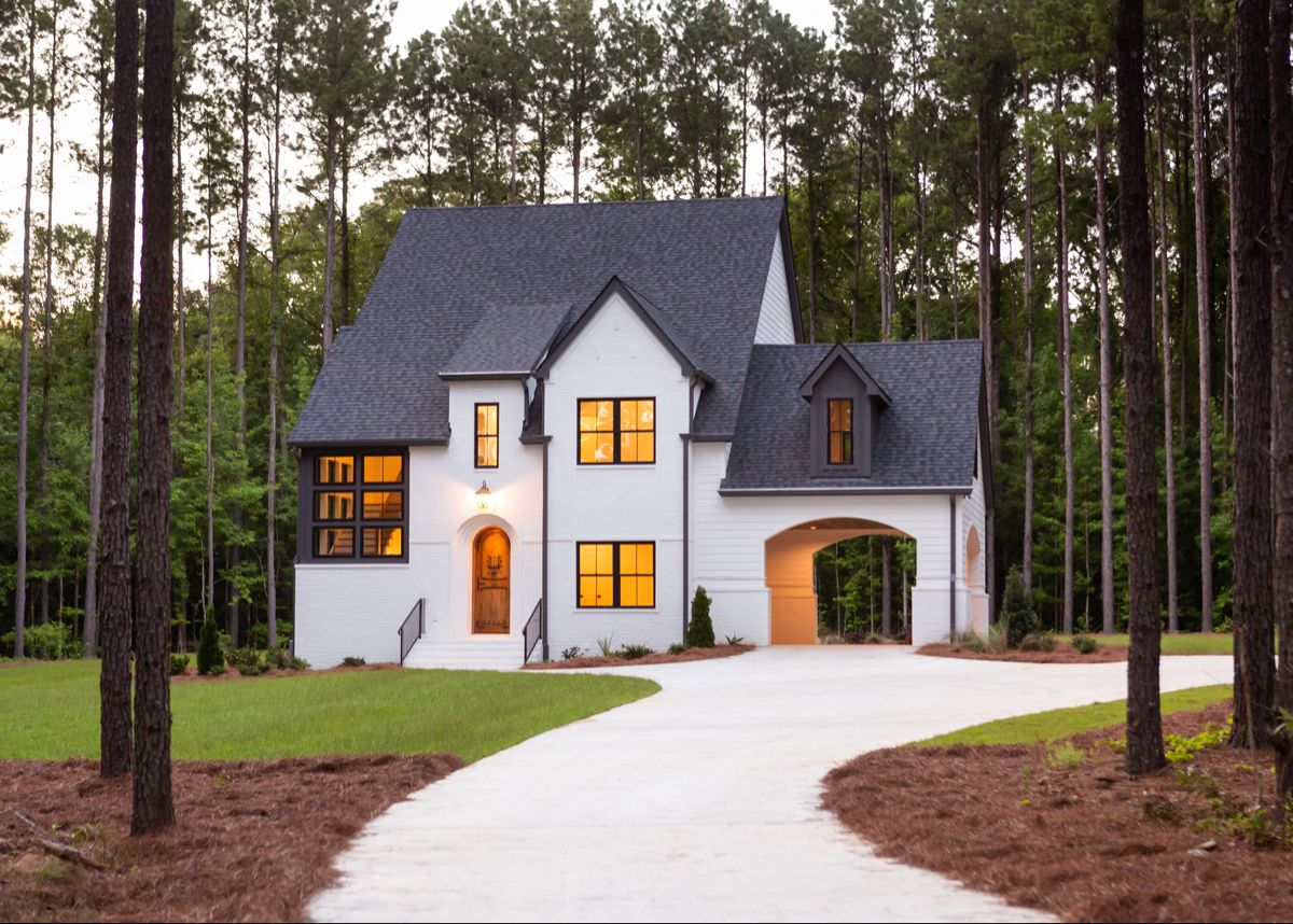 White Painted Brick Tudor With Black Metal Windows