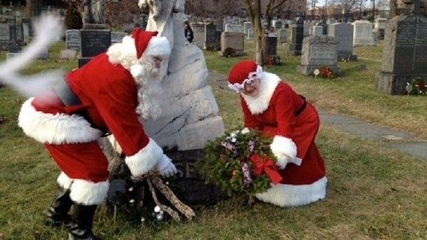 "Cemetery Director Eileen Markenstein was taking photos of the event and after she reviewed the images, she noticed a strange ghostly figure in one of them with Santa. ""If you look closely, you can see what looks like fingers on both sides of the white aura. I can't explain it, but it sure makes me feel like the spirits are very happy!"" Markenstein said."