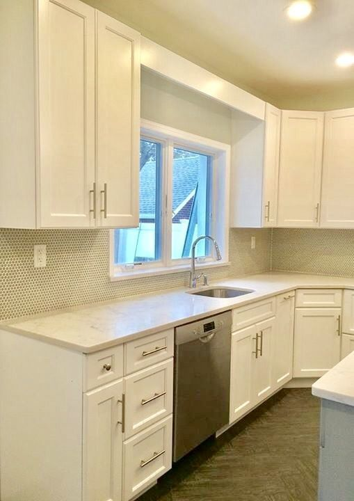 White kitchen cabinets from Kith Cabinetry. Gray brushed ...