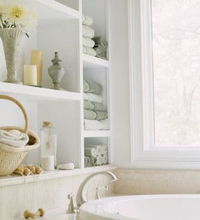 Shelf Life. Set-in shelves above the tub are a handy way to store extra towels for houseguests or your favorite decorative items.