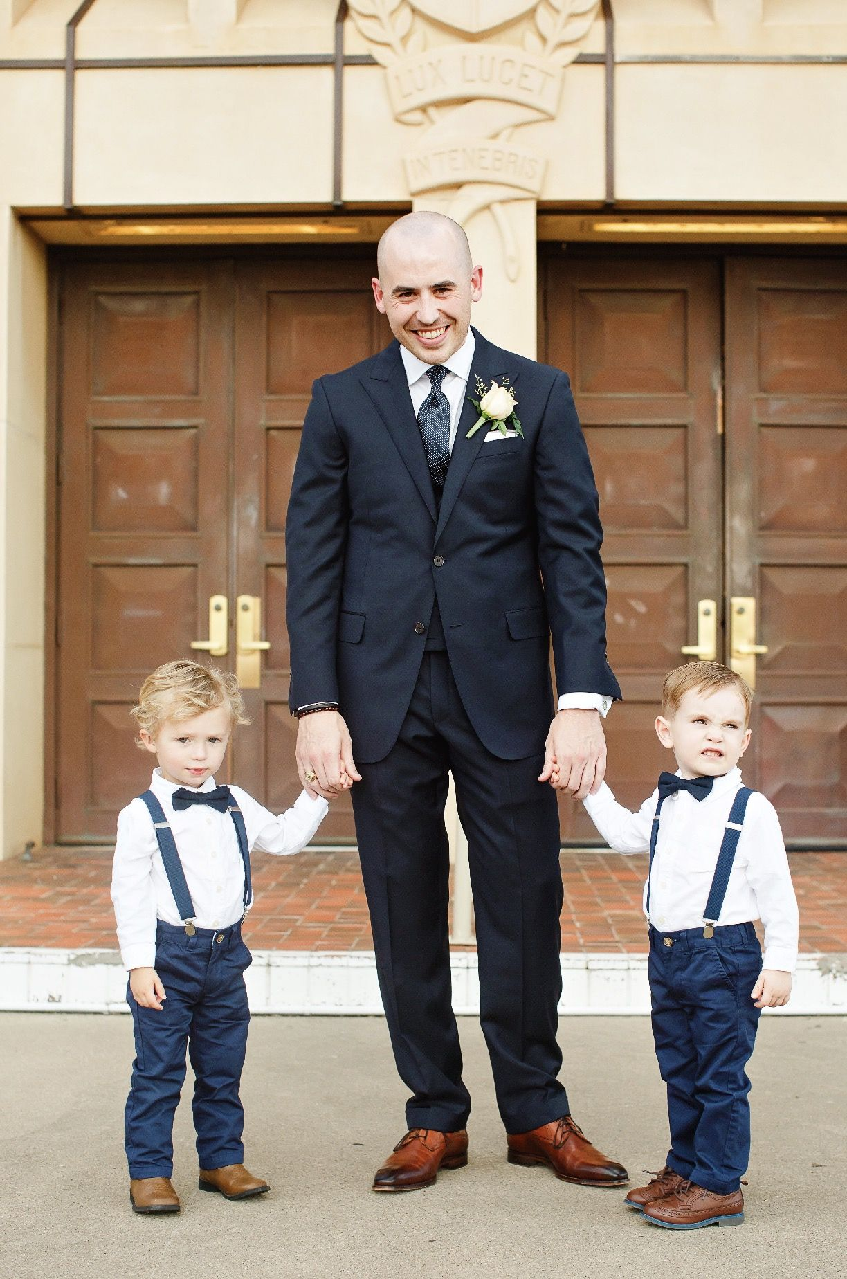 Navy blue suspenders and blue boys bow tie baby wedding outfit