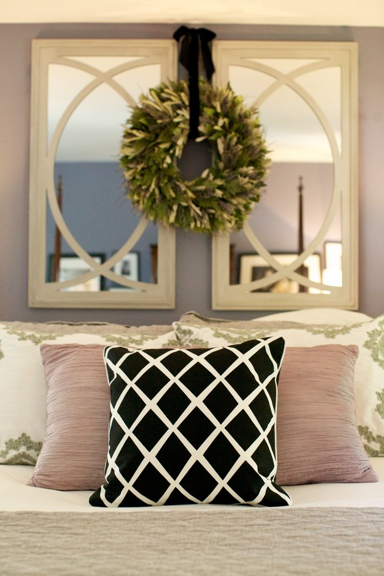 Master bedroom art above bed  Love the mirrors pillows and wreath  Family room  Pinterest