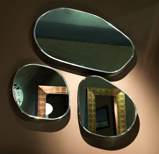 Circle Shape Wall Mirrors that can be rotated on the wall in any arrangement
