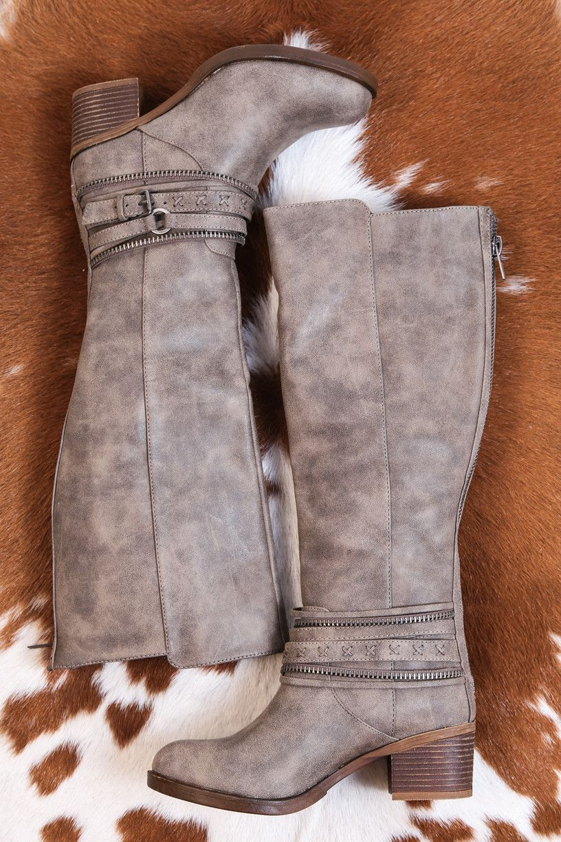 These tall riding boots have seam detail and several layers of faux zipper, buckle and leather straps to create an edgy look. Pairs best with black or dark jeans and a lighter blouse. - Manmade Materi
