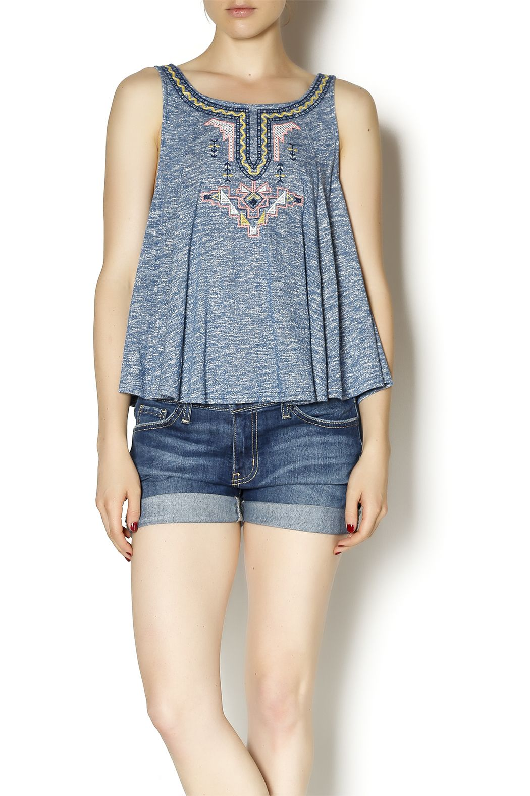 Embroidered blue-grey top with a cut out and tie at the back. This top is perfect for hot summer days with white shorts and your favorite sandals!