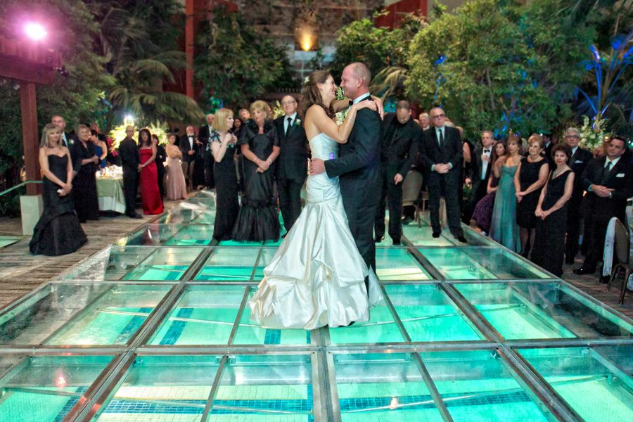 Pool Wedding Ideas floating flower spheres in the pool for cute decor I Want To Turn The Pool Into A See Through Dance Floor At The Reception