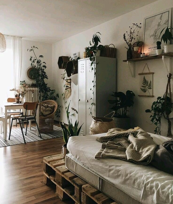 Photo of Boho bedroom with plants and textiles