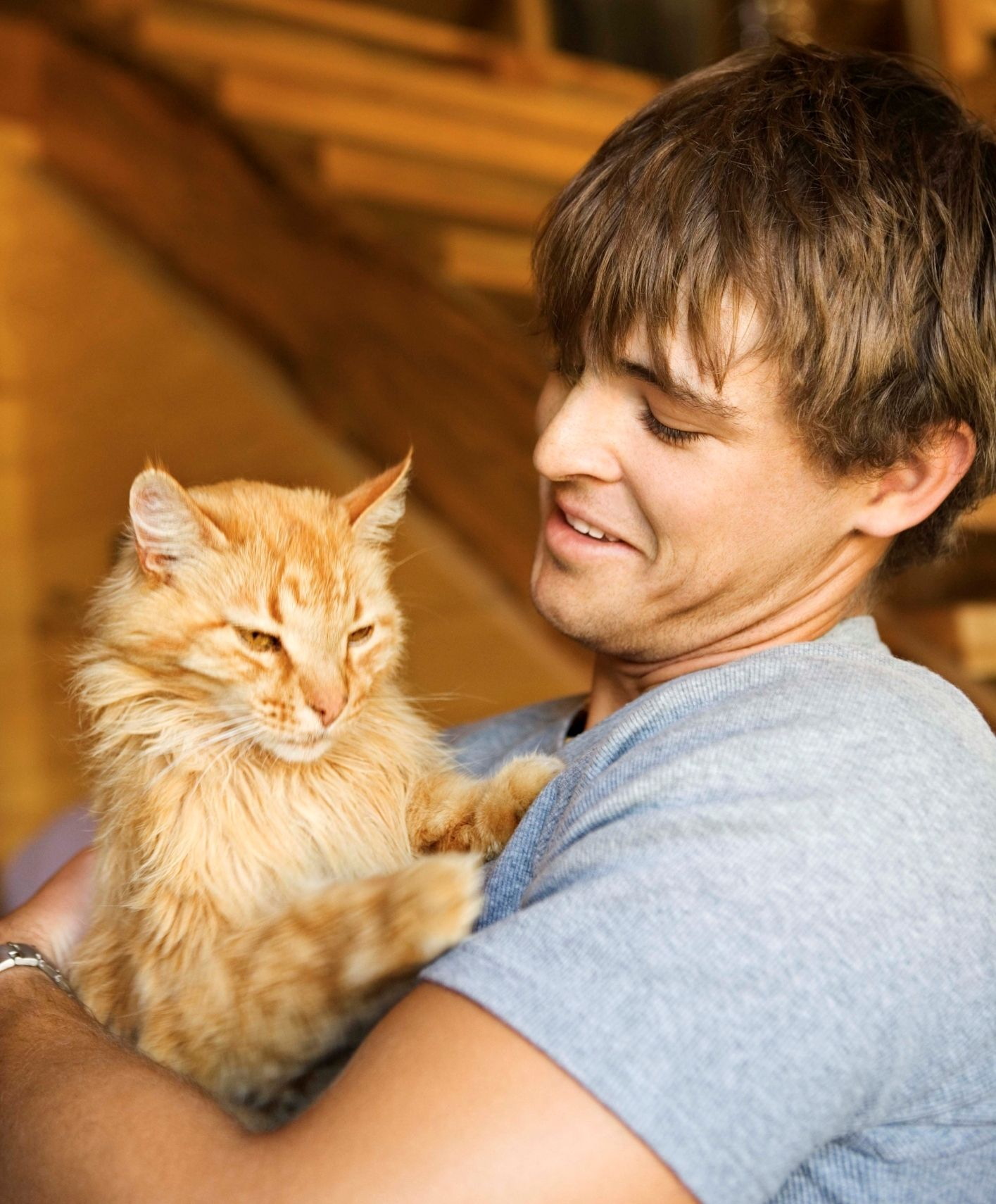 Man holding orange cat May is Pet Foster Care Awareness