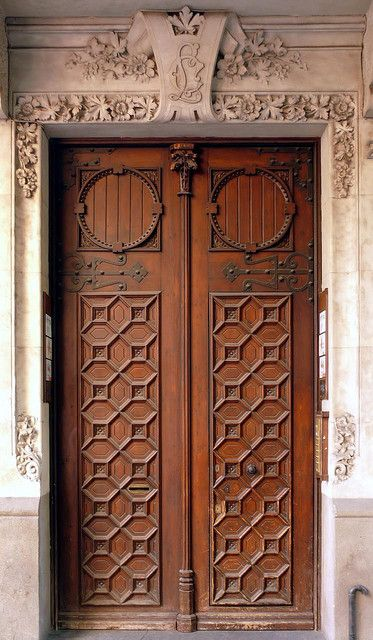 Exquisite carved wood door on a stone building in Barcelona ~- Wow gorgeous!