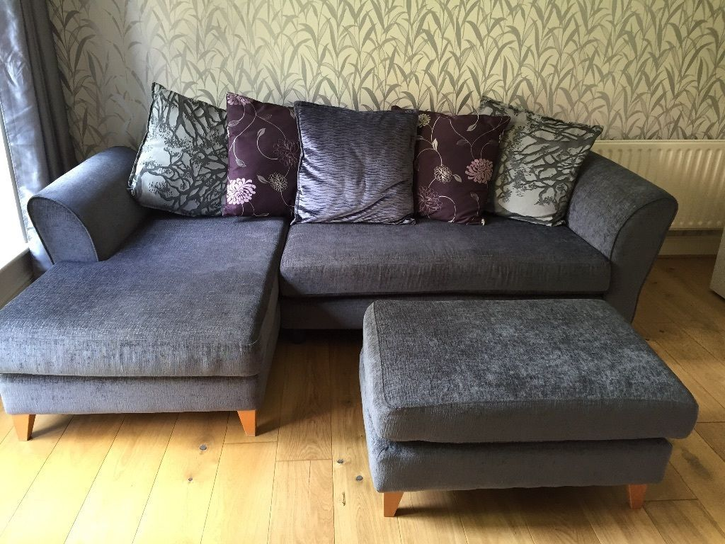 charcoal grey corner sofa and footstool with large cushions in