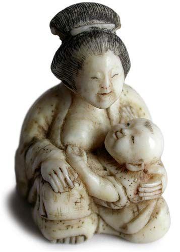 Nurishing Small Child Sig: Korakusai. Circa: 18th Century Recorded in: The Netsuke Handbook by Ueda Reikichi.