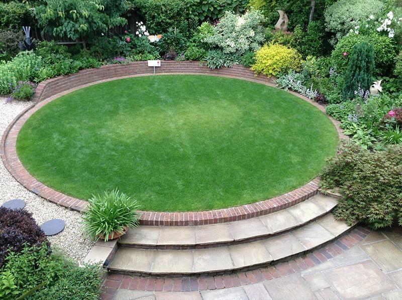 raised circular lawn as a central garden feature