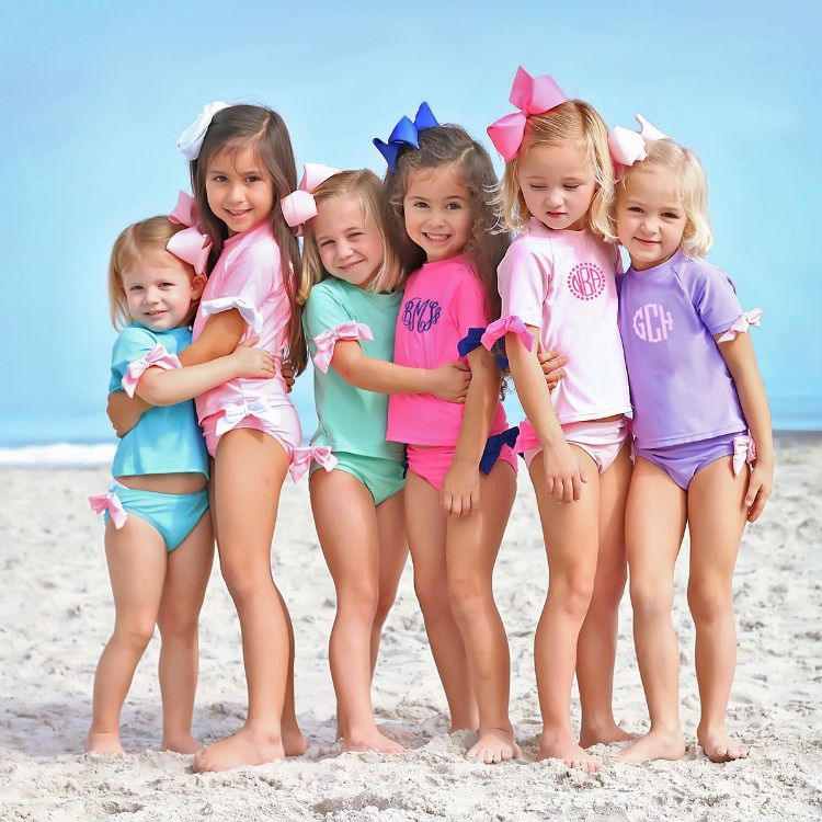 c7ce7ec25c73f4 Adorable two piece swimsuit with bow details. Short sleeve rash guard set.  UPF 50