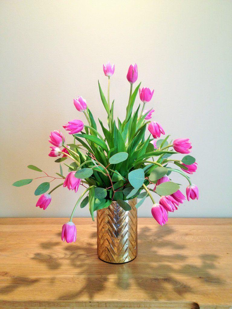 Pink tulips and eucalyptus flower arrangement in a gold mercury pink tulips and eucalyptus flower arrangement in a gold mercury vase reviewsmspy