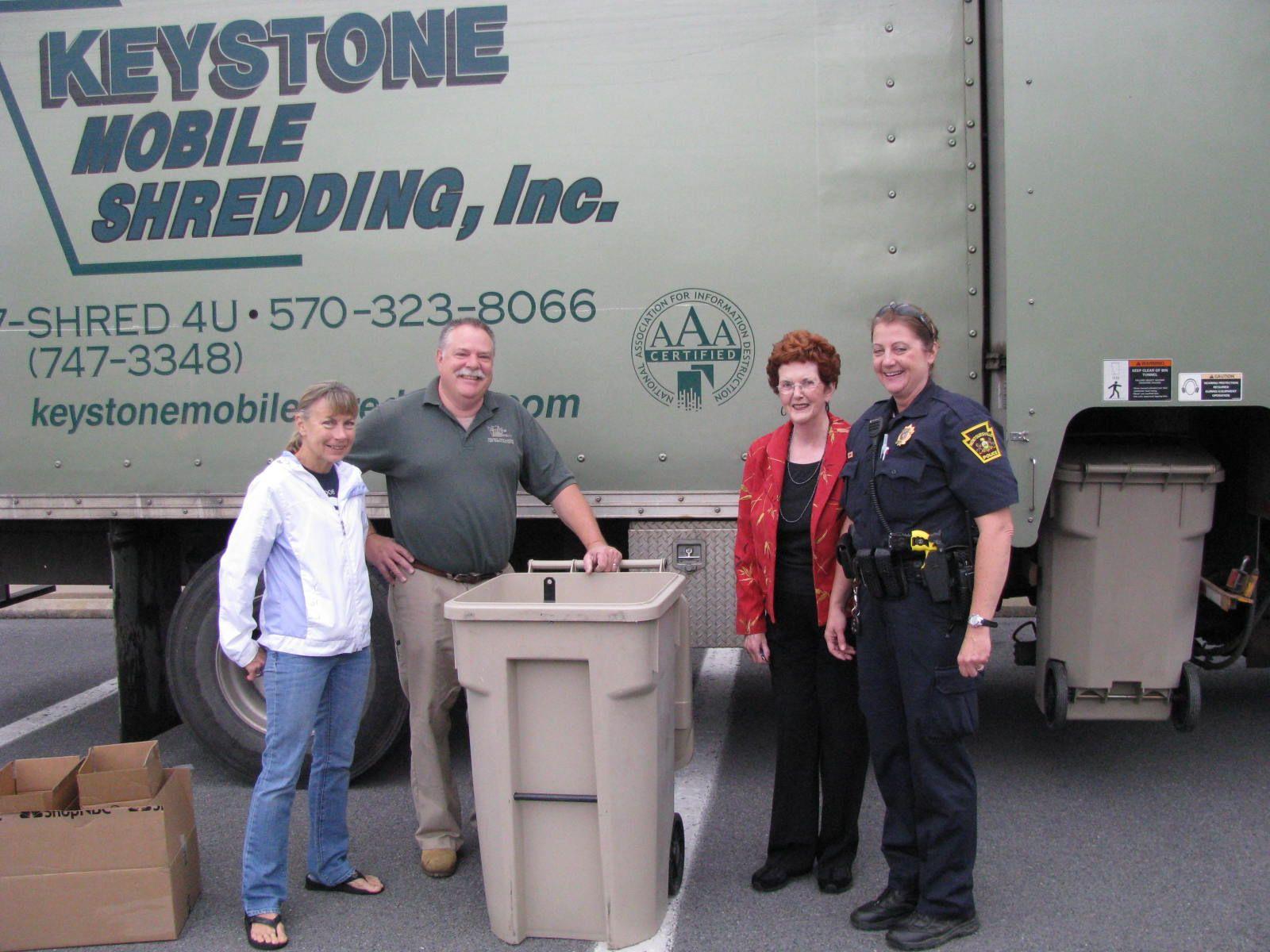 Keystone Mobile Shredding shows off its NAID logo as staff