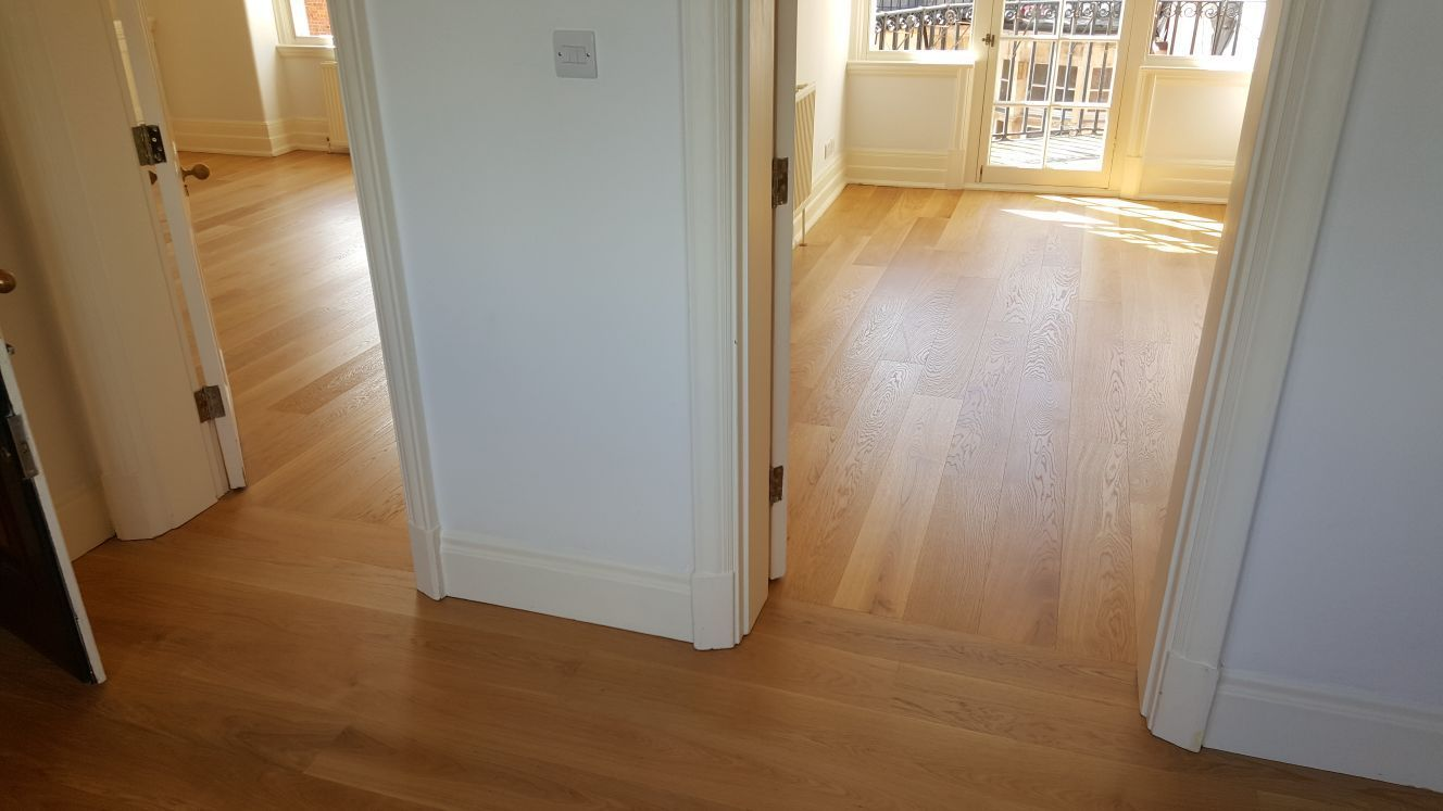 Changing The Direction Of Wood Flooring Can Help To Define The Space Here We Laid It One Way For The Hall And Wood Floors Stairs Cladding Floor Installation