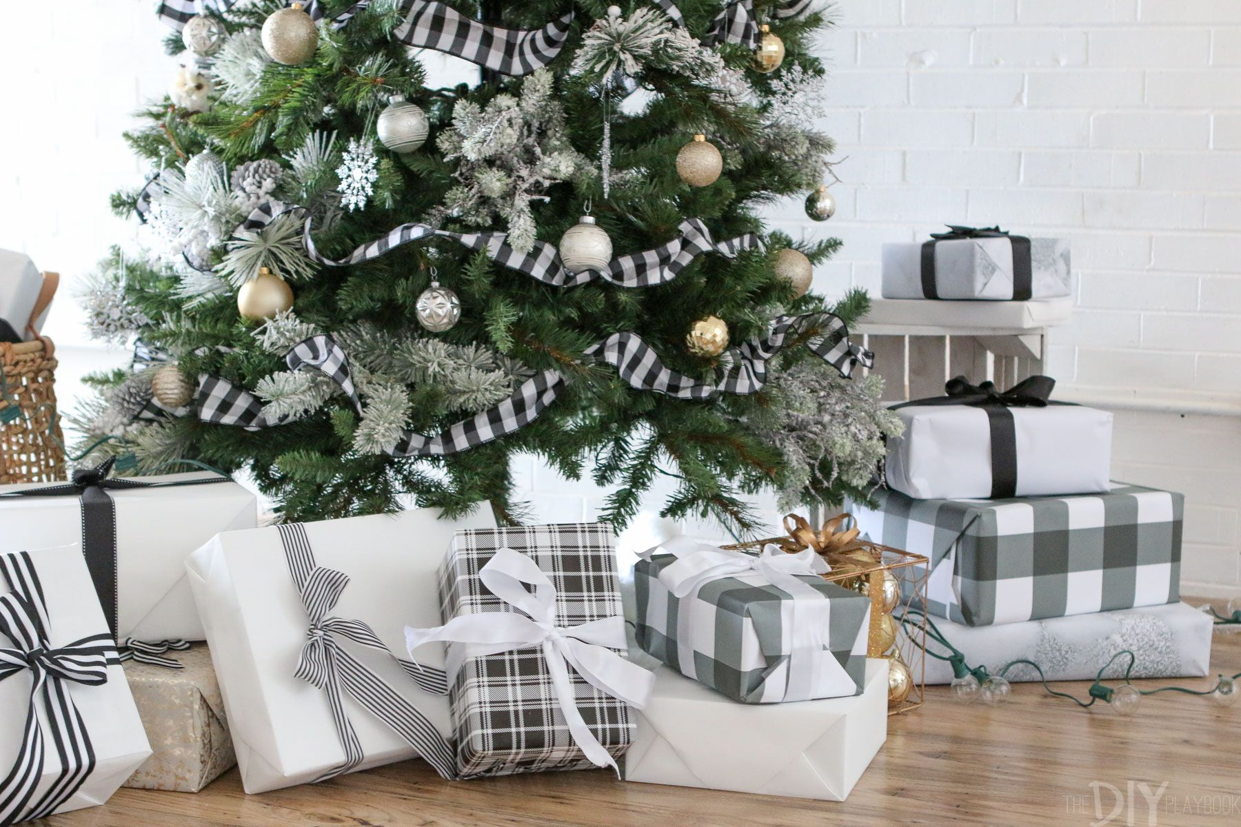 Black And White Christmas Tree For The Holidays Diy Playbook White Christmas Decor Christmas Tree With Presents Plaid Christmas Decor