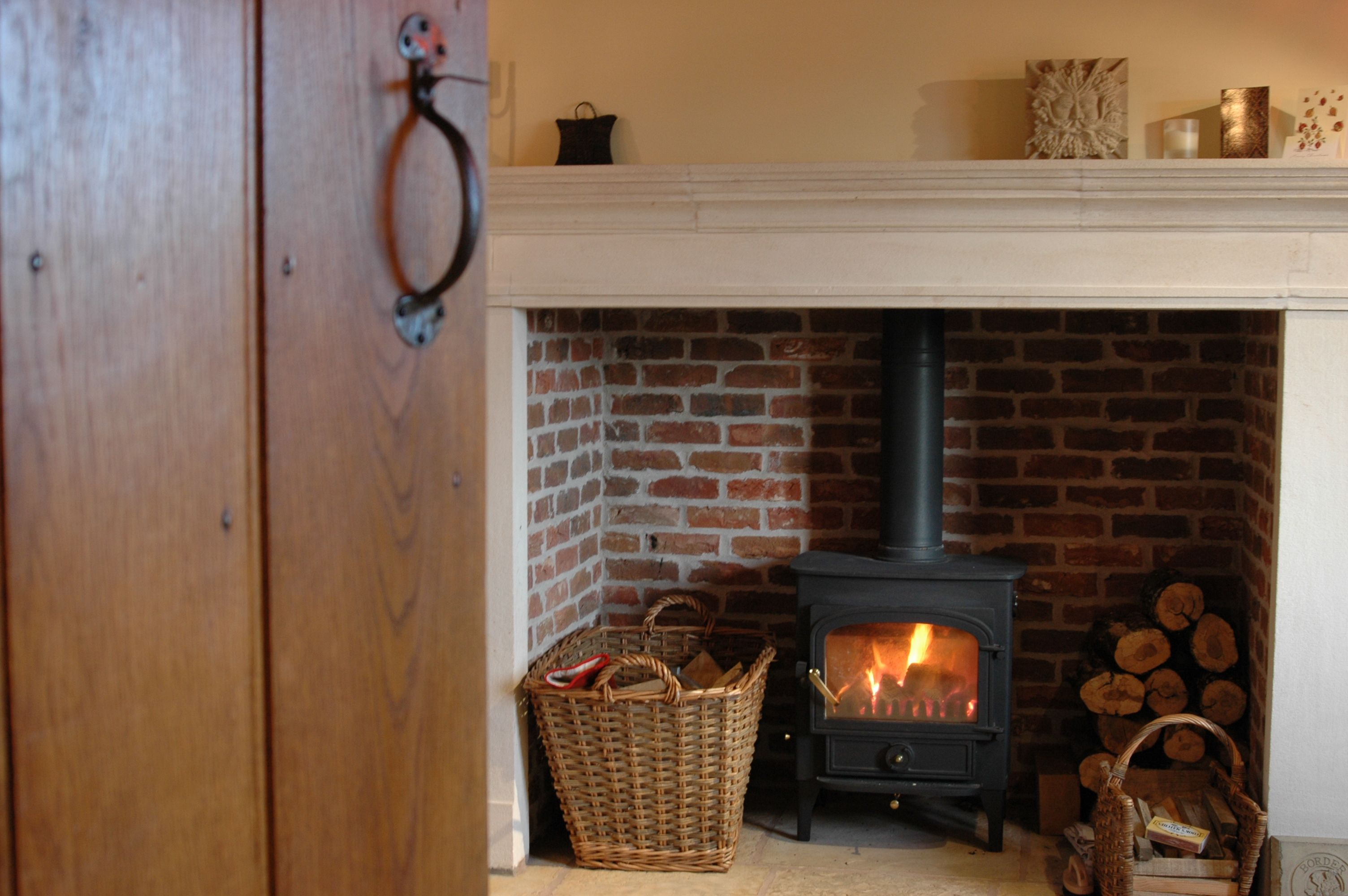 cottage border oak inglenook fireplace with limestone surround