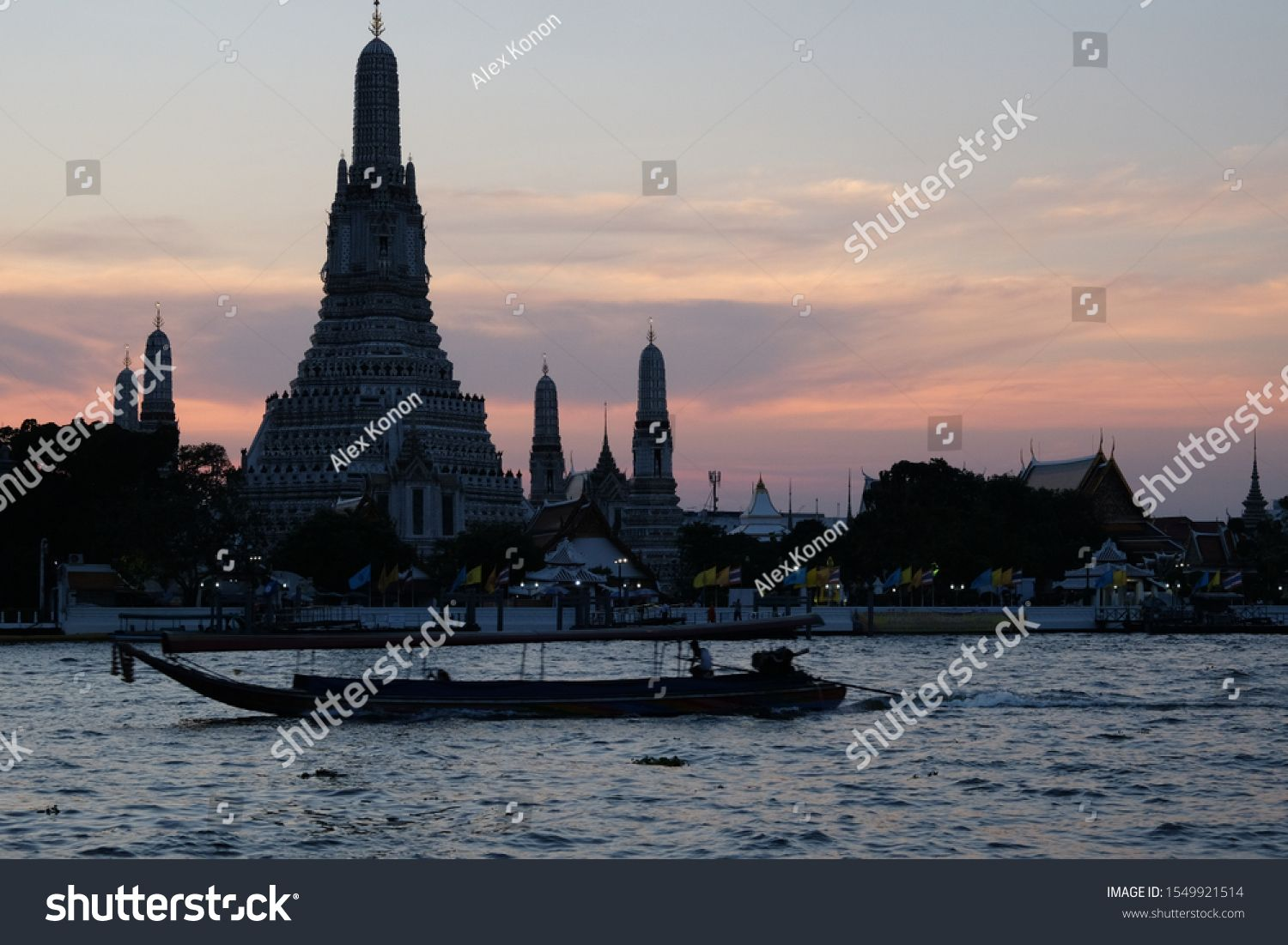 Bangkok, Thailand, December 25, 2018. Boats sail on the Chao Phraya river in the late evening. Wat