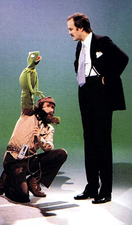 Jim Henson working Kermit the Frog, talking to John Cleese.