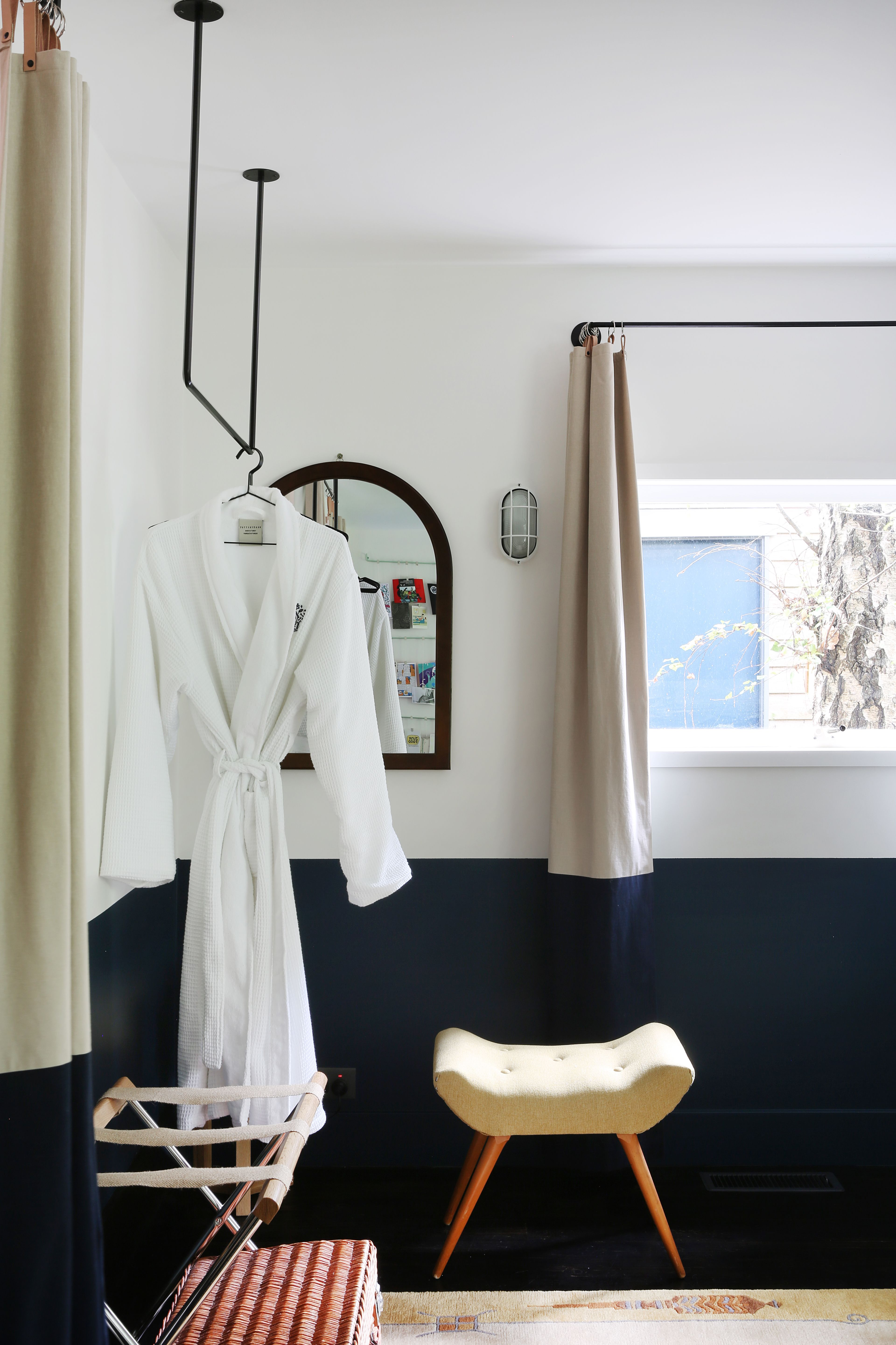 Bedroom with hanging clothes rod at Jackie