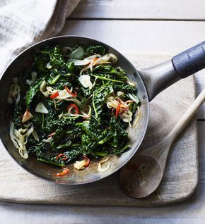 This is excellent as a side dish with roast chicken, or as a topping for bruschetta - griddle slices of good bread, rub with raw garlic, top with the cooked kale and then finish with a spoonful of mild, creamy young goats' cheese.
