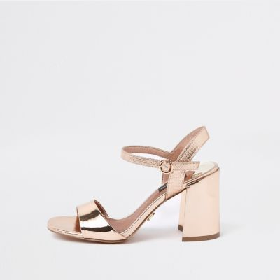 666d5a5217c0 Faux leather fabric Metallic finish Wide fit Strappy design Buckle  fastening Block heel