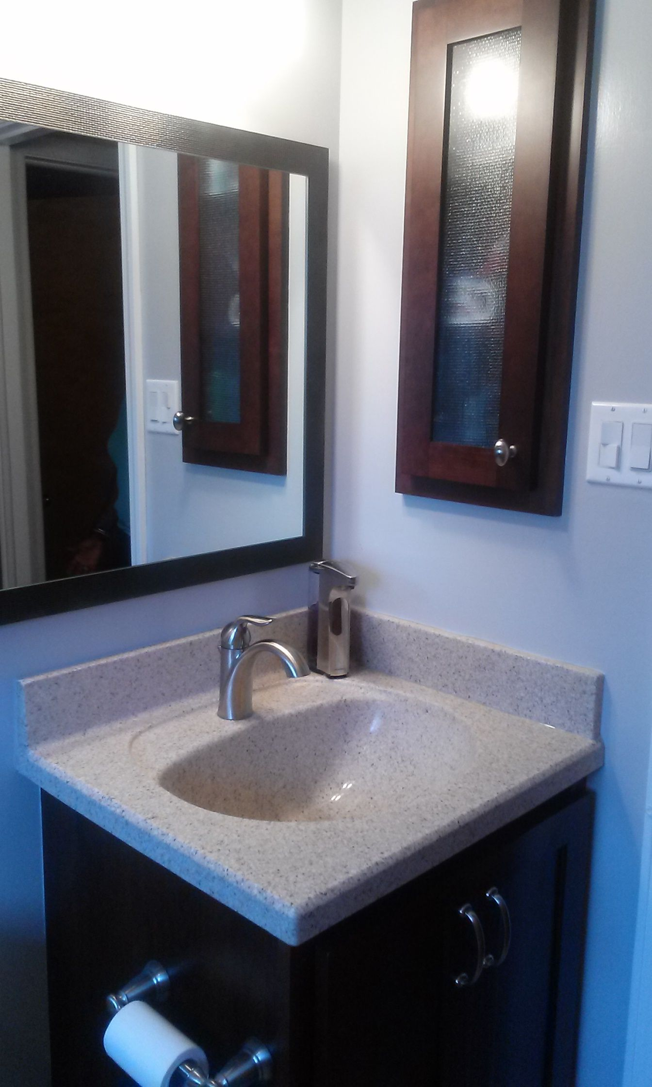 Dark Cabinetry with Marbelite countertop and splashes, tiled tub ...