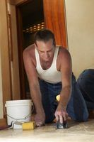 How To Get Dried Thinset Off The Top Of Tiles Before Grouting Hunker Stick On Tiles Clean Tile Tile Removal