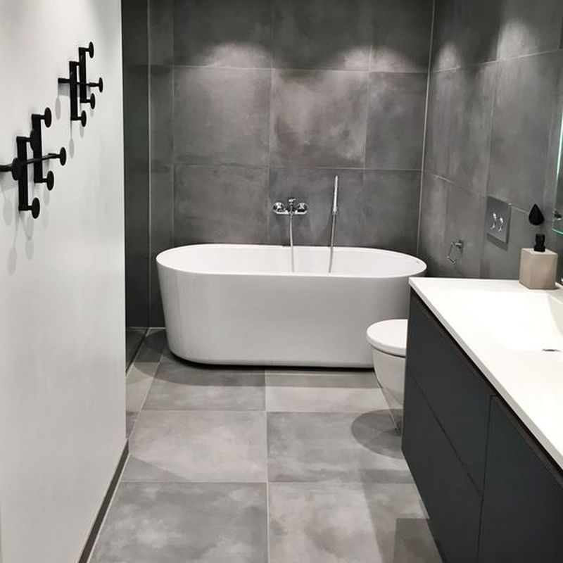 5 Interesting Ways To Decorate With Neutral Colored Bathroom Tiles Talkdecor In 2020 Grey Bathrooms Cement Bathroom Tile Bathroom
