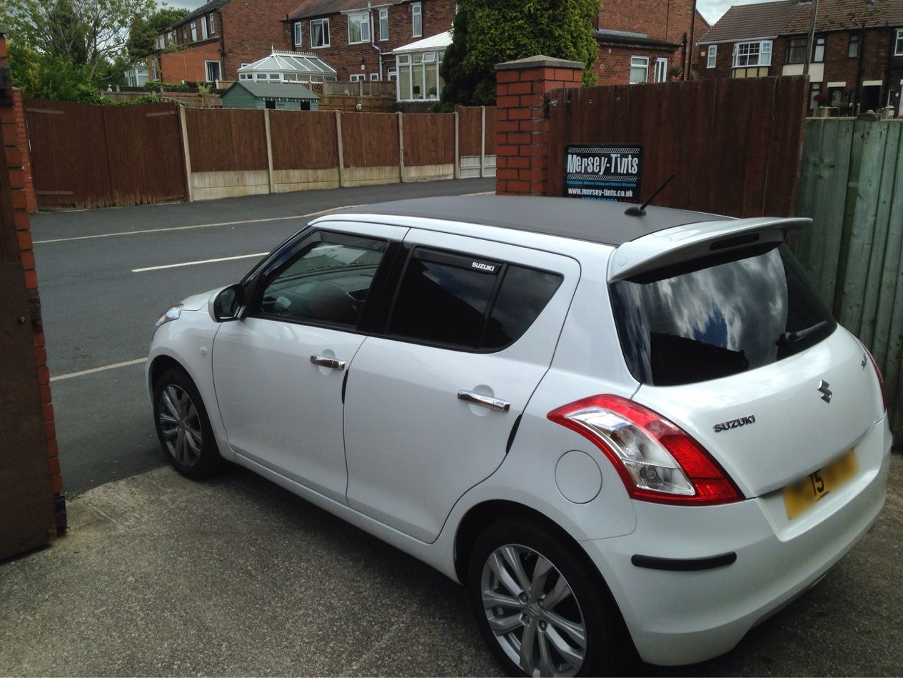 2015 suzuki swift in this morning for 5 carbon limo black