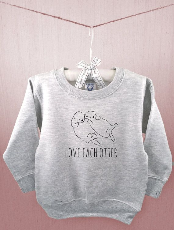 Toddler college sweatshirt reminding us to Love Each Otter (and love each other). This adorable sketch of otters holding hands is original and