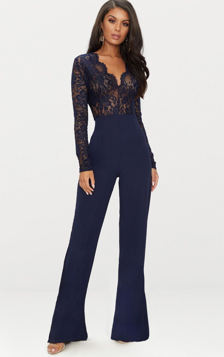 21076da6003 Navy Lace Long Sleeve Plunge JumpsuitFeaturing a luxe navy lace with long  sleeves and a plunge ne.