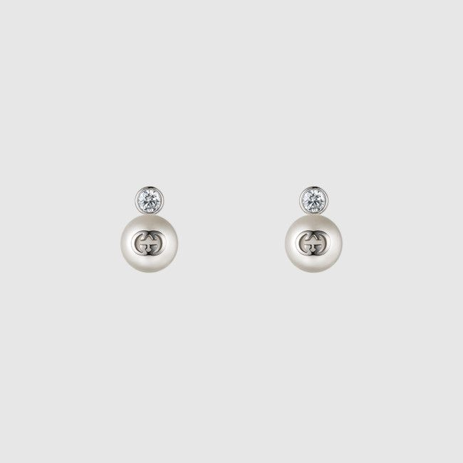 eb3190d6a80 Delicate Gucci earrings with Swarovski crystals and cream glass pearls with  an interlocking G detail.
