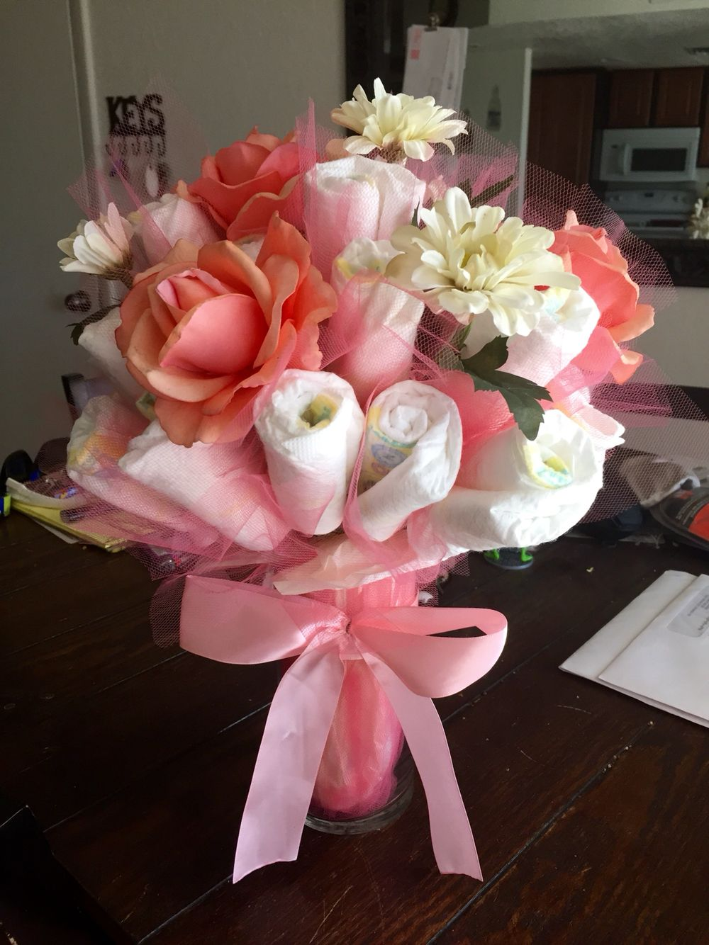 Baby shower diaper bouquet centerpiece hobby lobby diy for Pink diaper bouquet