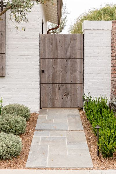 Pin By Andrea Velarde On Gates Fences Wood Gate Pavers Backyard White Brick Walls